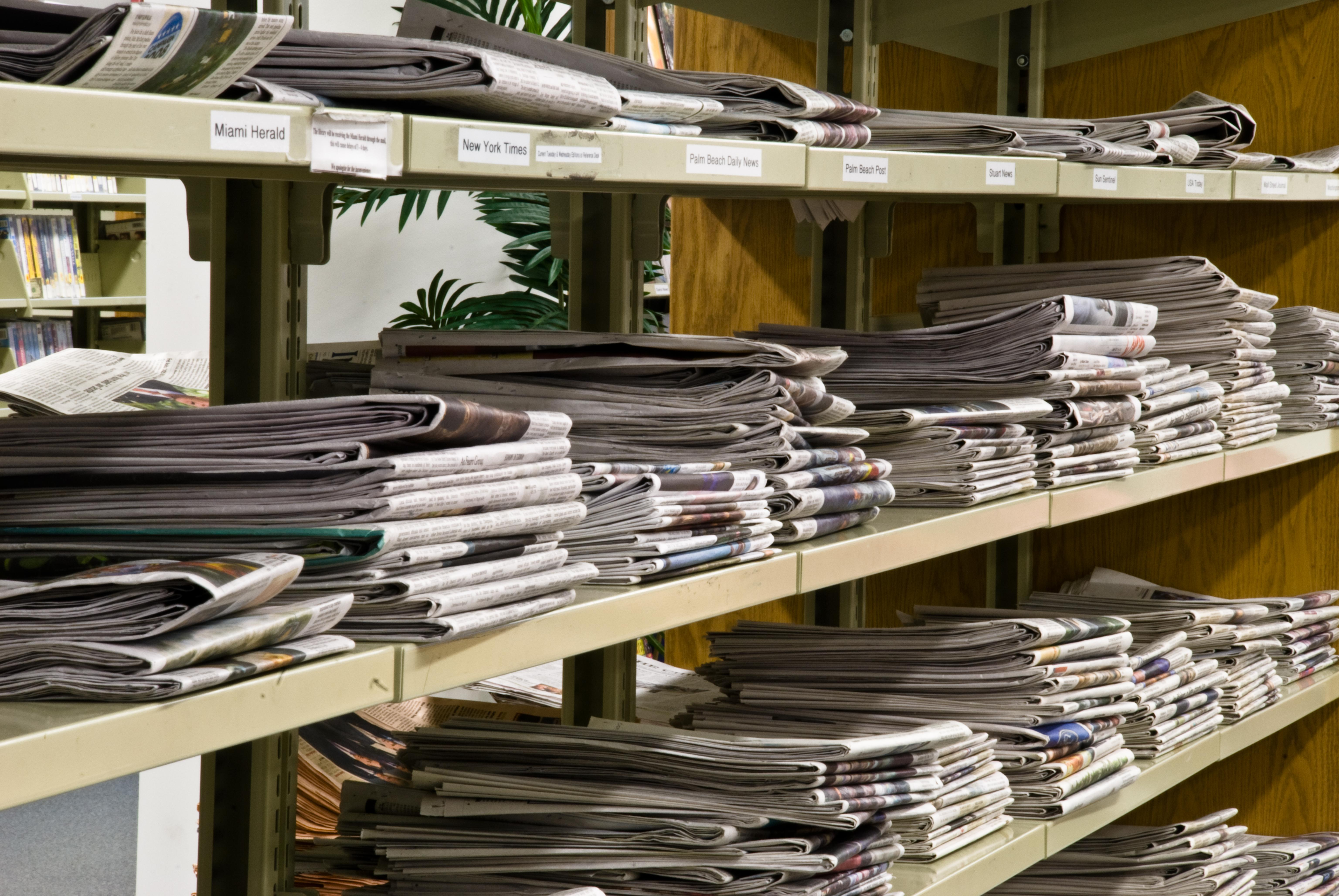 Stacks of newspapers that could be used for insulation